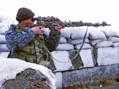 SVD rifle being held by soldier looking through scope